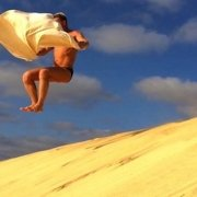 Towel surfing on sand dune, Sal
