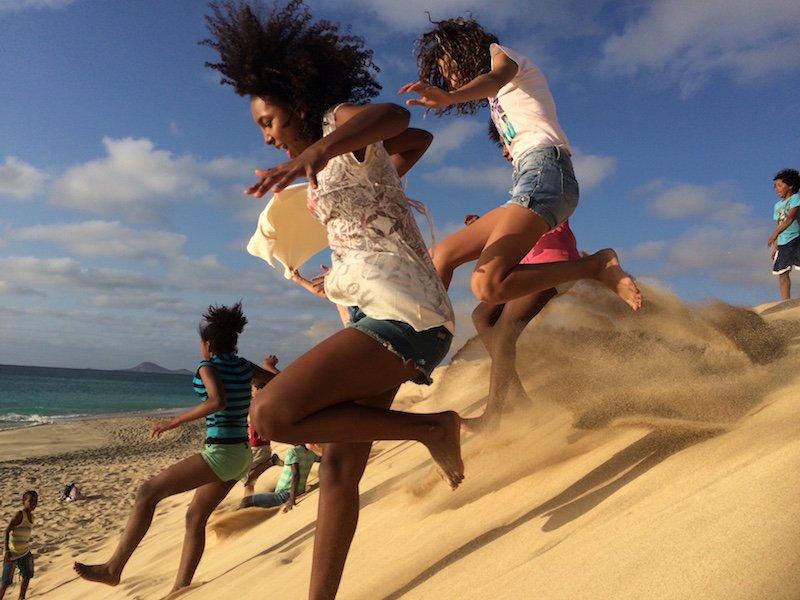 Sand dune running Ponta Preta beach Sal Cape Verde